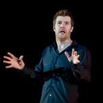 "Image for the Comedy programme ""Rhod Gilbert Live: The Man with the Flaming Battenberg Tattoo"""