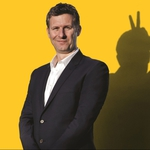 "Image for the Comedy programme ""Adam Hills Live: Happyism"""